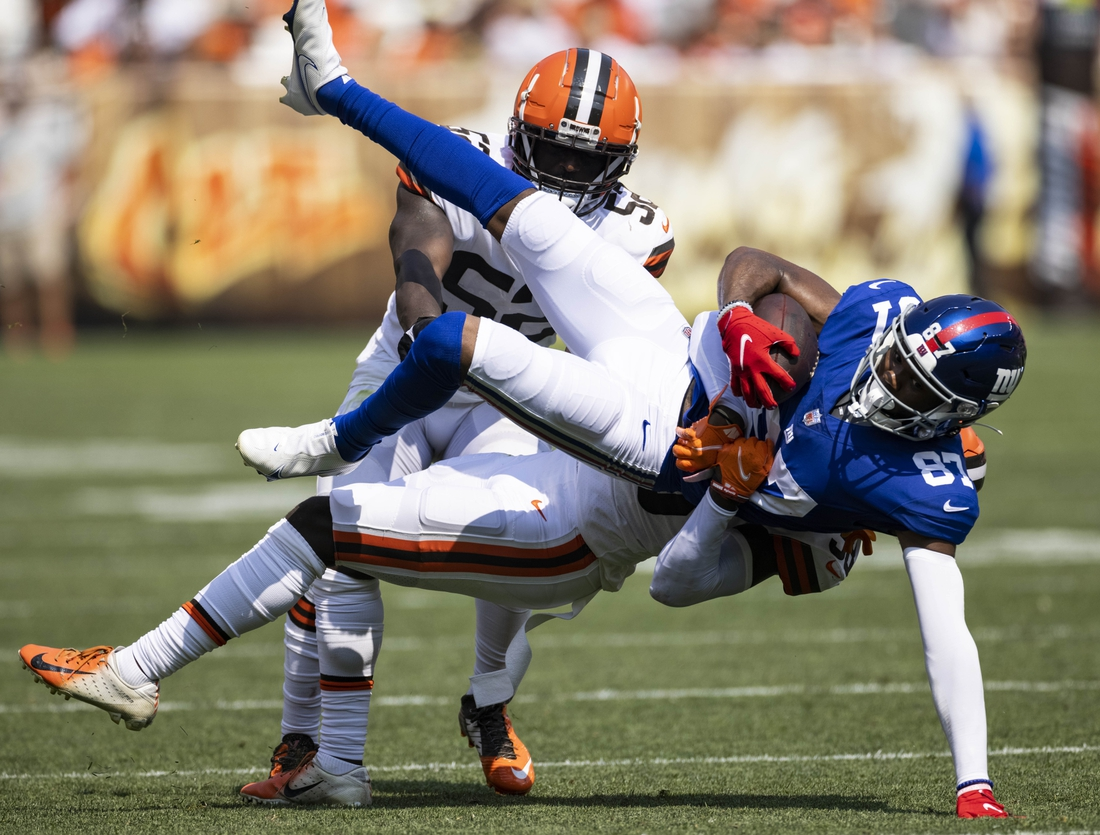 Aug 22, 2021; Cleveland, Ohio, USA; New York Giants wide receiver Damion Willis (87) falls as Cleveland Browns cornerback A.J. Green (38) tackles him during the fourth quarter at FirstEnergy Stadium. Mandatory Credit: Scott Galvin-USA TODAY Sports