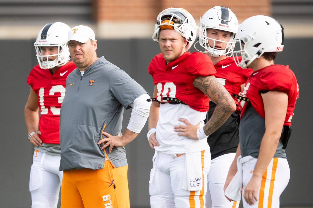 Tennessee head coach Josh Heupel stands with the quarterbacks during the team's football practice on Tuesday, August 10, 2021.  Kns Ut Football Practice Bp