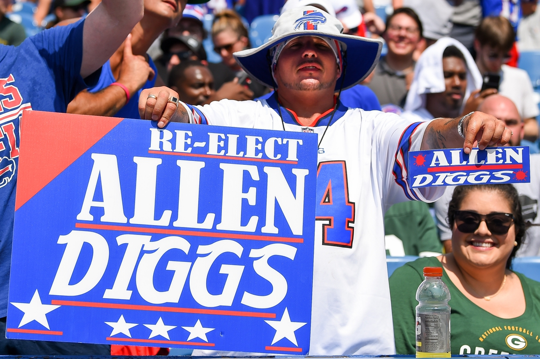Aug 28, 2021; Orchard Park, New York, USA; A Buffalo Bills fan holds up a sign for quarterback Josh Allen (not pictured) and wide receiver Stefon Diggs (not pictured) prior to the game against the Green Bay Packers at Highmark Stadium. Mandatory Credit: Rich Barnes-USA TODAY Sports