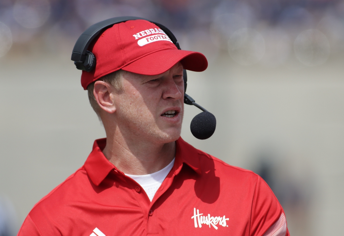 Aug 28, 2021; Champaign, Illinois, USA; Nebraska head coach Scott Frost watches his team in the first quarter with Illinois at Memorial Stadium. Mandatory Credit: Ron Johnson-USA TODAY Sports