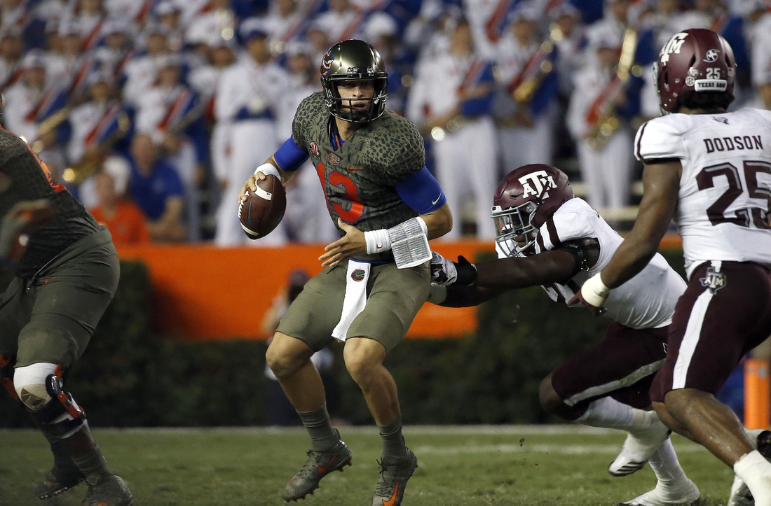 Oct 14, 2017; Gainesville, FL, USA;Florida Gators quarterback Feleipe Franks (13) runs out of the pocket as Texas A&M Aggies defensive end Michael Clemons (48) pressures  during the first half at Ben Hill Griffin Stadium. Mandatory Credit: Kim Klement-USA TODAY Sports