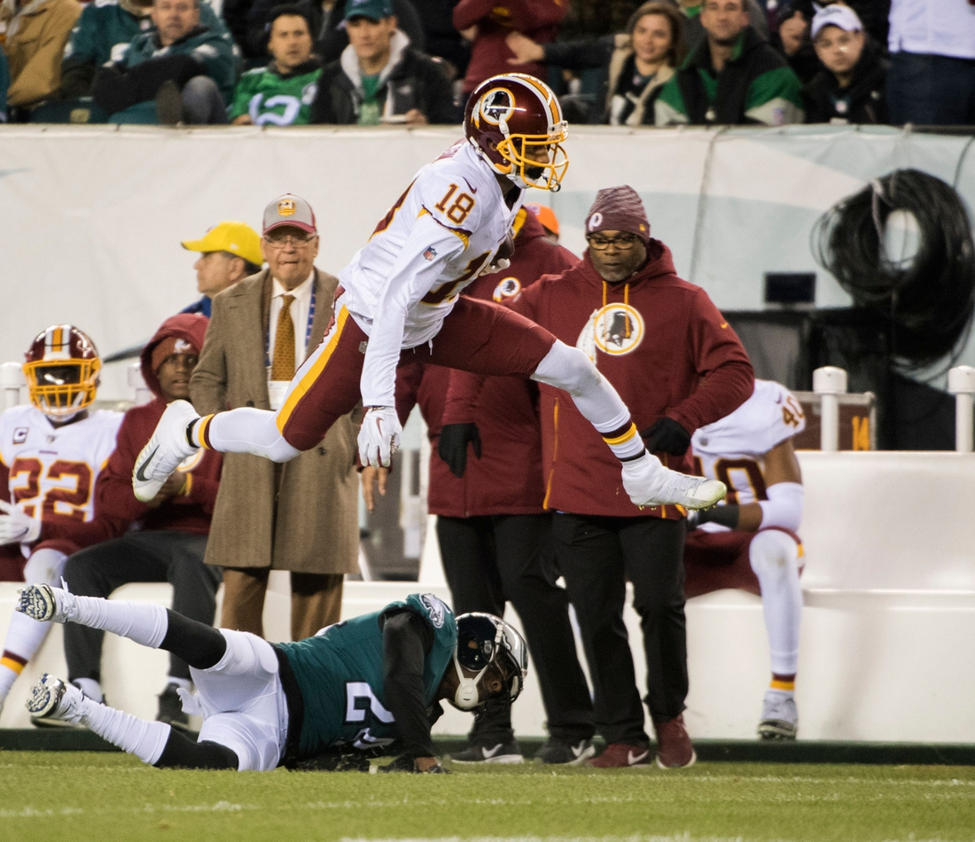 Redskins' Josh Doctson (18) leaps while carrying the ball against the Eagles Monday, Dec. 3, 2018 in Philadelphia. The Eagles won 28-13.  Jl Birds 12318 04