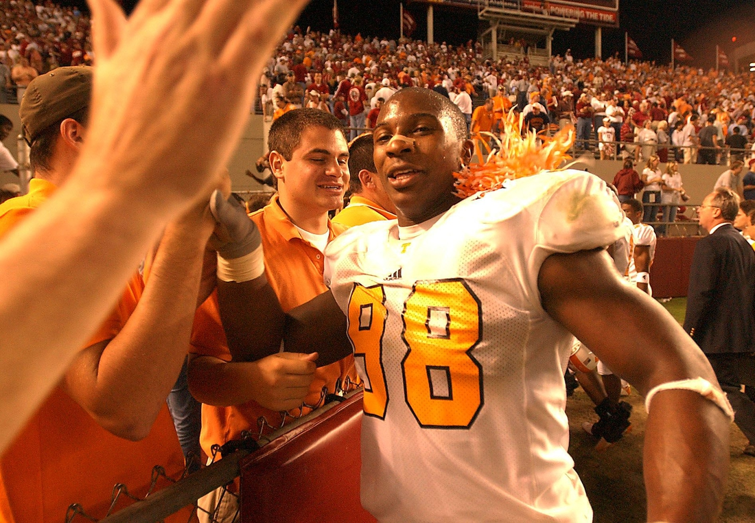 Tennessee's (98) Parys Haralson heads for the fans at the end of the fifth overtime and their win  over Alabama.        10/25/2003  Utalabama6 Mp227