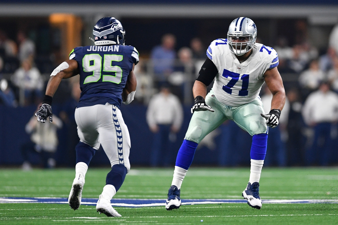 Jan 5, 2019; Arlington, TX, USA; Dallas Cowboys offensive tackle La'el Collins (71) pass protects against Seattle Seahawks defensive end Dion Jordan (95) in the second quarter in a NFC Wild Card playoff football game at AT&T Stadium. Mandatory Credit: Shane Roper-USA TODAY Sports