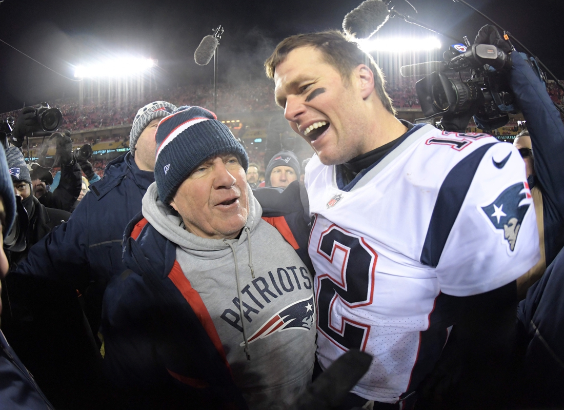 Jan 20, 2019; Kansas City, MO, USA; New England Patriots quarterback Tom Brady (12) celebrates with coach Bill Belichick after the AFC Championship game against the Kansas City Chiefs at Arrowhead Stadium. The Patriots defeated the Chiefs 37-31 in overtime to advance to fifth Super Bowl in eight seasons. Mandatory Credit: Kirby Lee-USA TODAY Sports