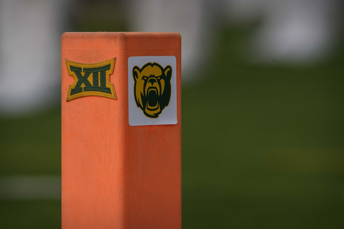 Aug 31, 2019; Waco, TX, USA; A view of the Baylor Bears logo and the Big 12 conference logo on an end zone pylon during the game between the Baylor Bears and the Stephen F. Austin Lumberjacks at McLane Stadium. Mandatory Credit: Jerome Miron-USA TODAY Sports