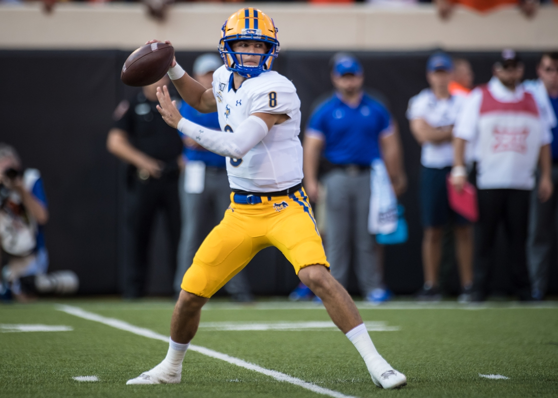 Sep 7, 2019; Stillwater, OK, USA; McNeese State Cowboys quarterback Cody Orgeron (8) drops back to pass against the Oklahoma State Cowboys during the first quarter at Boone Pickens Stadium. Mandatory Credit: Rob Ferguson-USA TODAY Sports