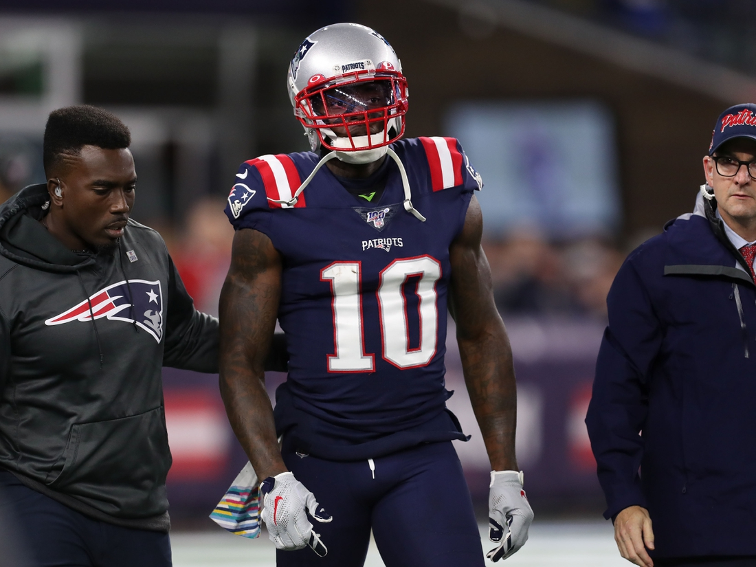 Oct 10, 2019; Foxborough, MA, USA; New England Patriots wide receiver Josh Gordon (10) is helped off of the field during the first half against the New York Giants at Gillette Stadium. Mandatory Credit: Paul Rutherford-USA TODAY Sports