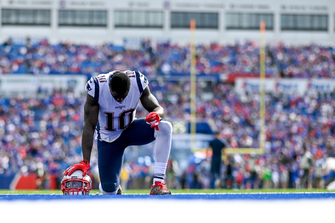 Sep 29, 2019; Orchard Park, NY, USA; New England Patriots wide receiver Josh Gordon (10) takes a knee in the end zone prior to the game between the Buffalo Bills and the New England Patriots at New Era Field. Mandatory Credit: Douglas DeFelice-USA TODAY Sports
