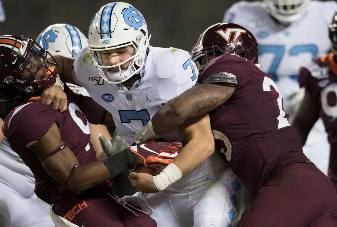 Oct 19, 2019; Blacksburg, VA, USA; North Carolina Tar Heels quarterback Sam Howell (7) is sacked on a two point conversion attempt against the Virginia Tech Hokies in overtime at Lane Stadium. Mandatory Credit: Lee Luther Jr.-USA TODAY Sports
