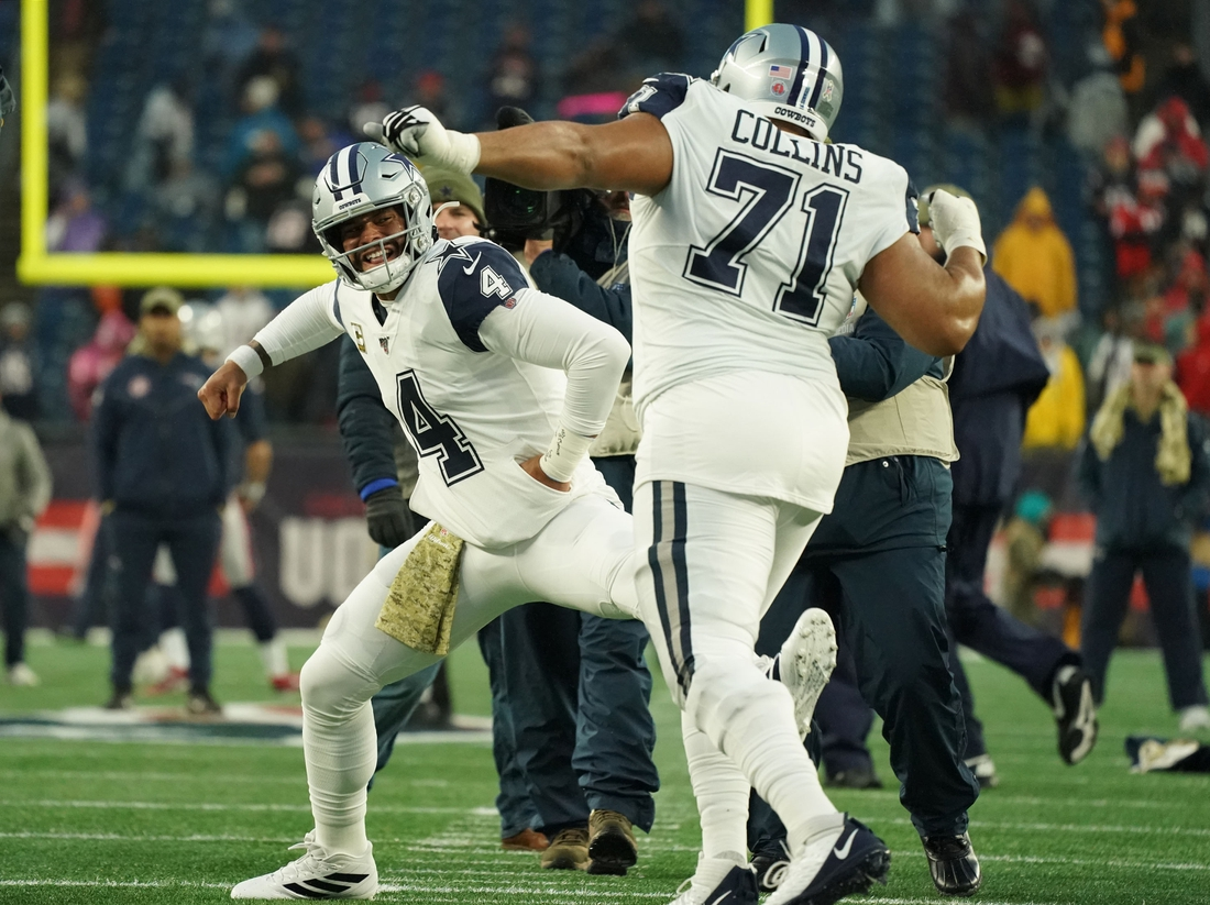 Nov 24, 2019; Foxborough, MA, USA; Dallas Cowboys quarterback Dak Prescott (4) reacts with offensive tackle La'el Collins (71) during warm up before the start of the game against the New England Patriots at Gillette Stadium. Mandatory Credit: David Butler II-USA TODAY Sports