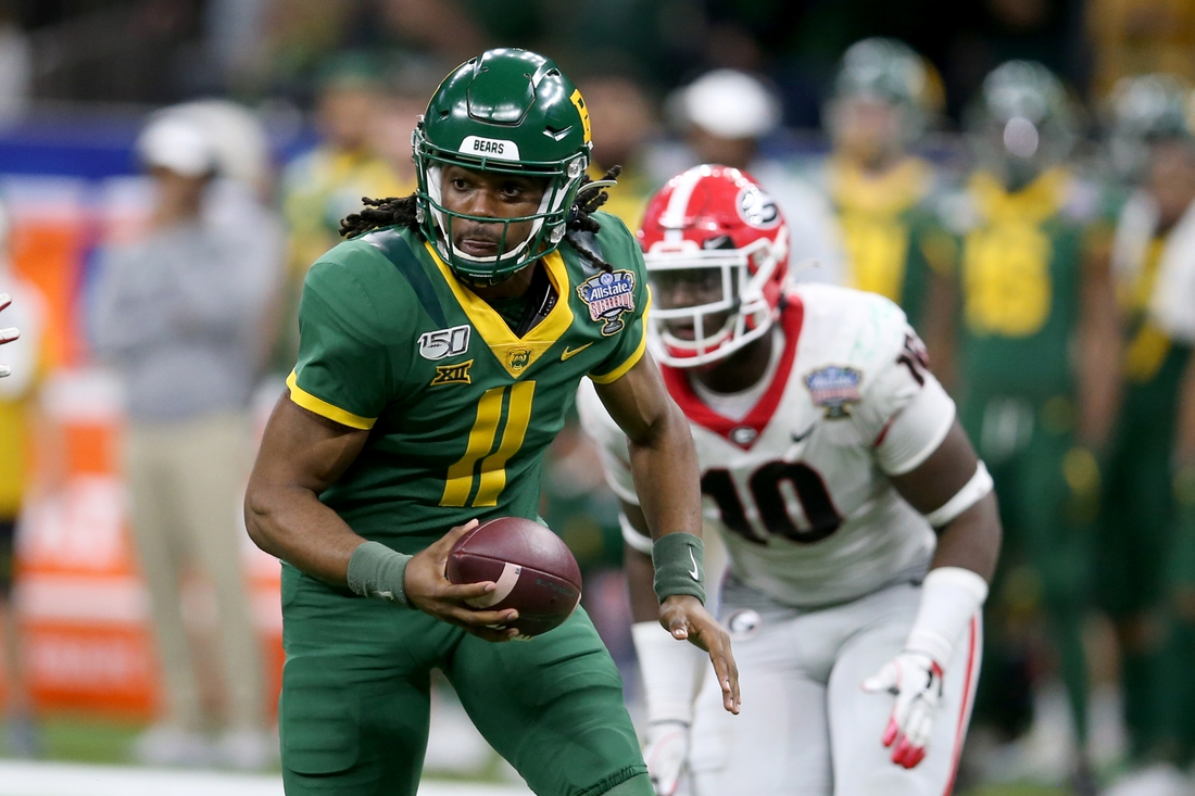 Jan 1, 2020; New Orleans, Louisiana, USA; Baylor Bears quarterback Gerry Bohanon (11) scrambles from pressure by the Georgia Bulldogs in the second half of the Sugar Bowl at the Mercedes-Benz Superdome. Mandatory Credit: Chuck Cook-USA TODAY Sports