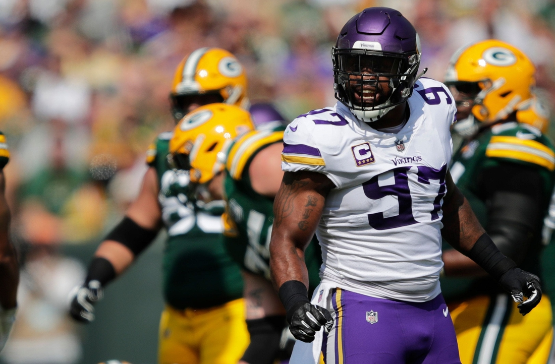 Minnesota Vikings defensive end Everson Griffen (97) celebrates after sacking Green Bay Packers quarterback Aaron Rodgers (12) in the first quarter during their football game Sunday, Sept. 16, 2018, at Lambeau Field in Green Bay, Wis.  Uscp 71xb6nzxky91i3cxus6e Original  Syndication: PackersNews  Syndication: Unknown