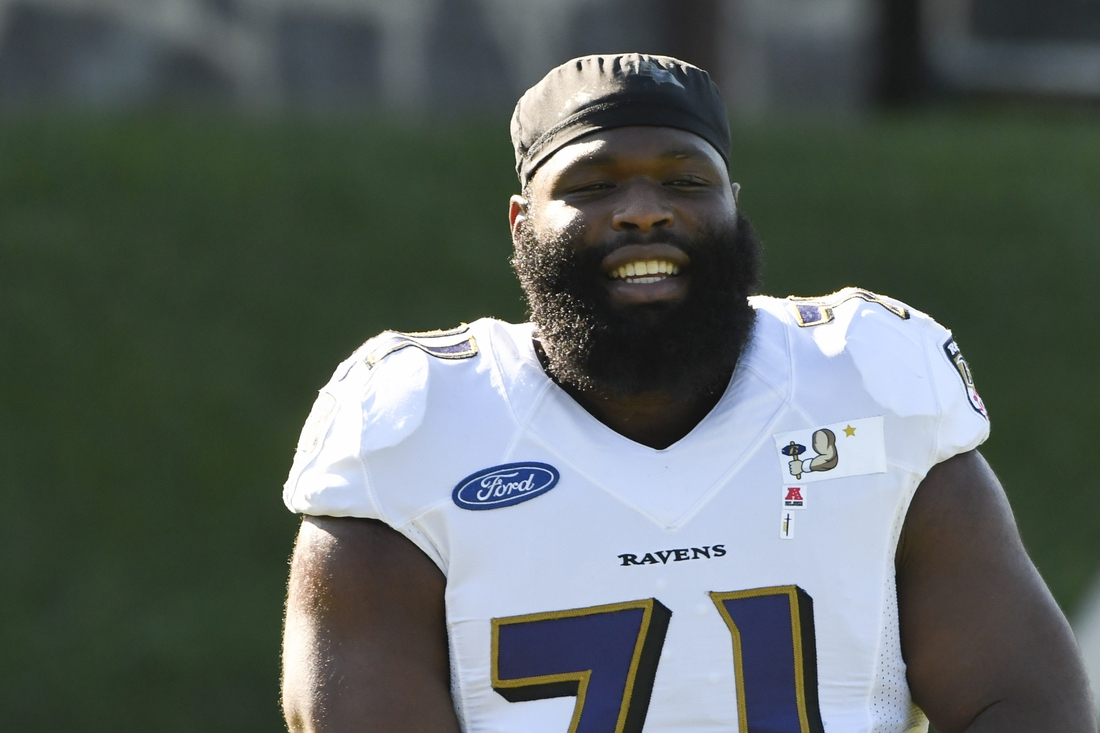 Aug 18, 2020; Owings Mills, Maryland, USA;  Baltimore Ravens defensive tackle Justin Ellis (71) stands on the field during the morning session of training camp at Under Armour Performance Center. Mandatory Credit: Tommy Gilligan-USA TODAY Sports