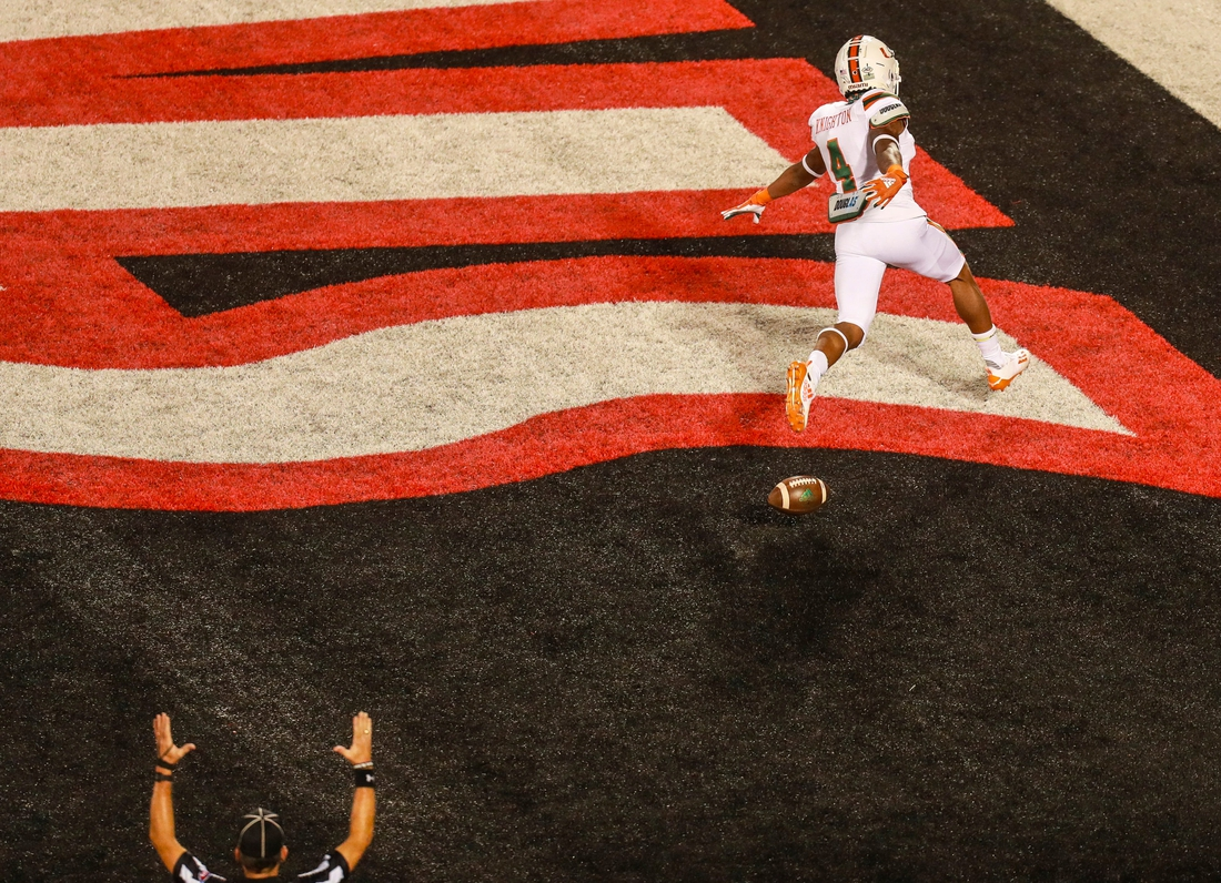 Miami's Jaylan Knighton spreads his arms as he swooped into the end zone easily after a 50-plus yard TD run against the Cards during the Louisville-Miami game Saturday night. Sept. 19, 2020  Louisville Vs Miami 2020
