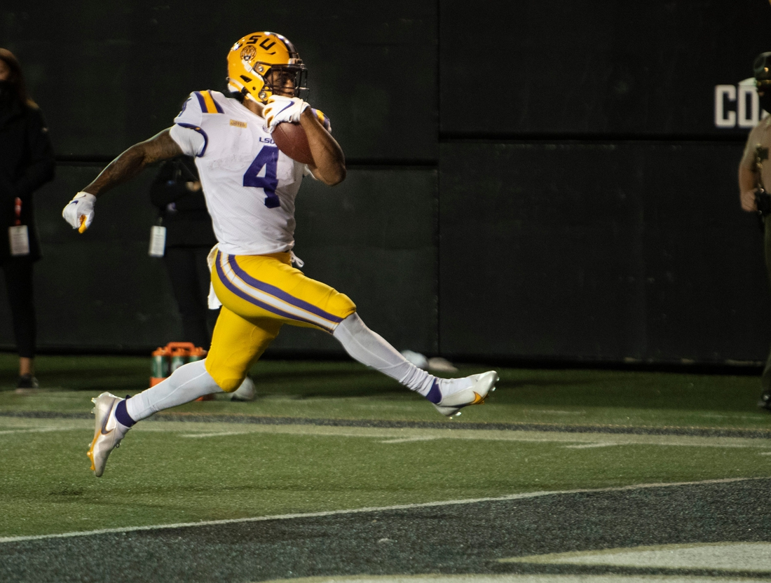 LSU running back John Emery Jr. (4) hi-steps into the end zone for a touchdown against Vanderbilt during the fourth quarter at Vanderbilt Stadium Saturday, Oct. 3, 2020 in Nashville, Tenn.  Nas Vandy Lsu Gamer 007