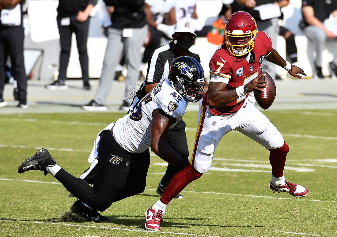 Oct 4, 2020; Landover, Maryland, USA; Baltimore Ravens linebacker Jaylon Ferguson (45) sacks Washington Football Team quarterback Dwayne Haskins (7) during the second half at FedExField. Mandatory Credit: Brad Mills-USA TODAY Sports