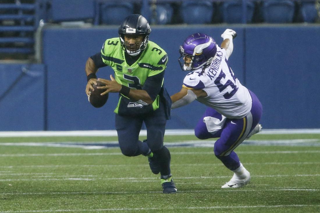 Oct 11, 2020; Seattle, Washington, USA; Seattle Seahawks quarterback Russell Wilson (3) escapes from Minnesota Vikings middle linebacker Eric Kendricks (54) during the fourth quarter at CenturyLink Field. Mandatory Credit: Joe Nicholson-USA TODAY Sports
