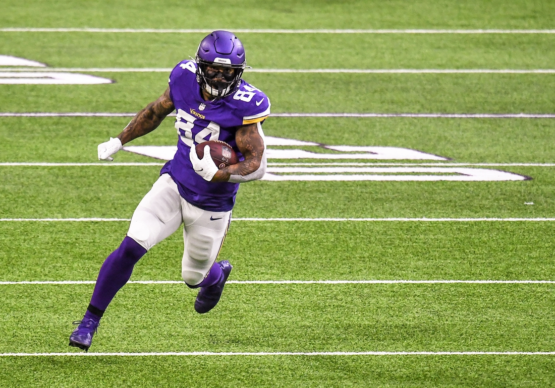 Oct 18, 2020; Minneapolis, Minnesota, USA;  Minnesota Vikings tight end Irv Smith Jr. (84) runs with the ball after a catch for a 36-yard gain in the first quarter against the Atlanta Falcons at U.S. Bank Stadium. Mandatory Credit: Nick Wosika-USA TODAY Sports