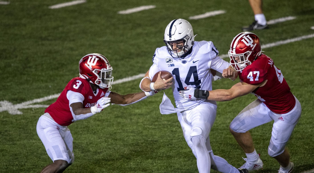 Oct 24, 2020; Bloomington, Indiana, USA;  Penn State Nittany Lions quarterback Sean Clifford (14) attempts to avoid tackle from Indiana Hoosiers linebacker Micah McFadden (47) and Indiana Hoosiers defensive back Tiawan Mullen (3)  late in the second half of the game at Memorial Stadium. The Indiana Hoosiers defeated the Penn State Nittany Lions 36 to 35.  Mandatory Credit: Marc Lebryk-USA TODAY Sports