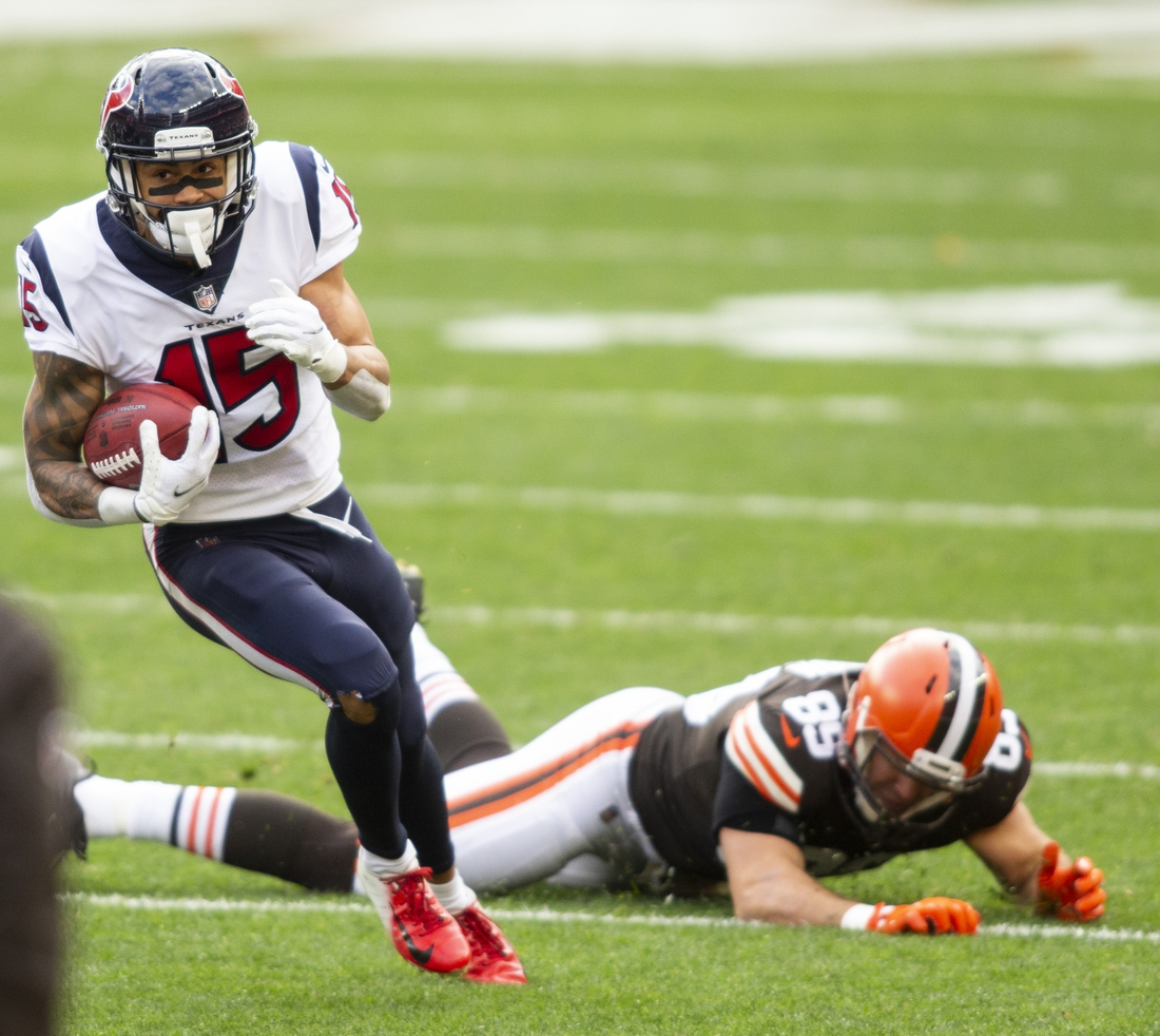 Nov 15, 2020; Cleveland, Ohio, USA; Houston Texans wide receiver Will Fuller (15) runs the ball past Cleveland Browns tight end Stephen Carlson (89) during the second quarter at FirstEnergy Stadium. Mandatory Credit: Scott Galvin-USA TODAY Sports