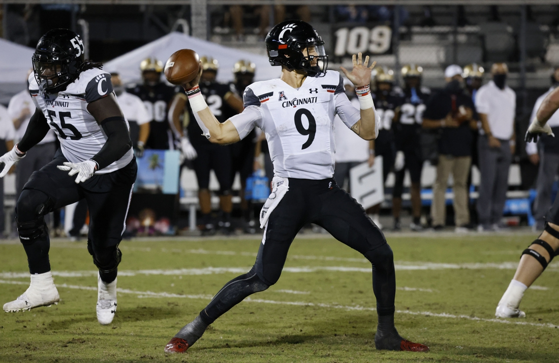 Nov 21, 2020; Orlando, Florida, USA; Cincinnati Bearcats quarterback Desmond Ridder (9) throws a pass against the UCF Knights during the second half at the Bounce House. Mandatory Credit: Reinhold Matay-USA TODAY Sports