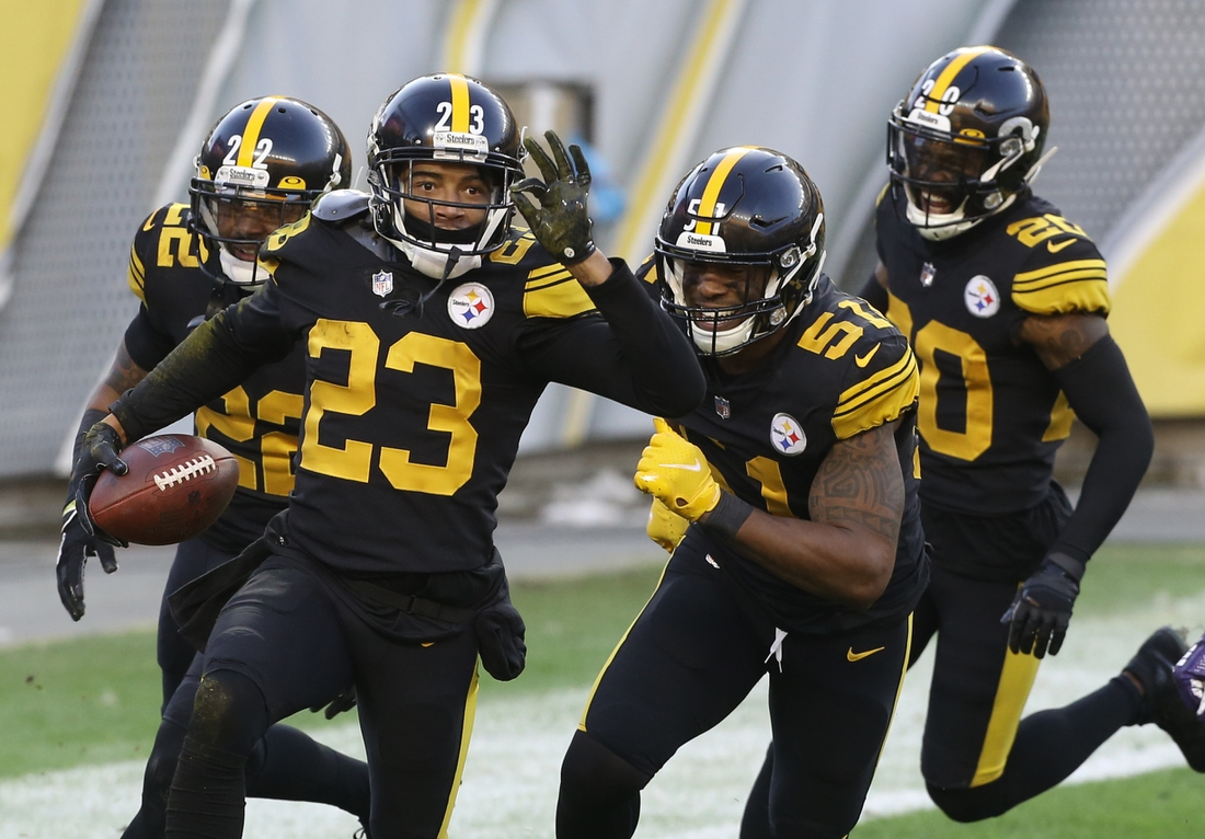 Dec 2, 2020; Pittsburgh, Pennsylvania, USA;  Pittsburgh Steelers cornerback Joe Haden (23) celebrates his fourteen yard interception return for a touchdown with teammates against the Baltimore Ravens during the first quarter at Heinz Field. Mandatory Credit: Charles LeClaire-USA TODAY Sports