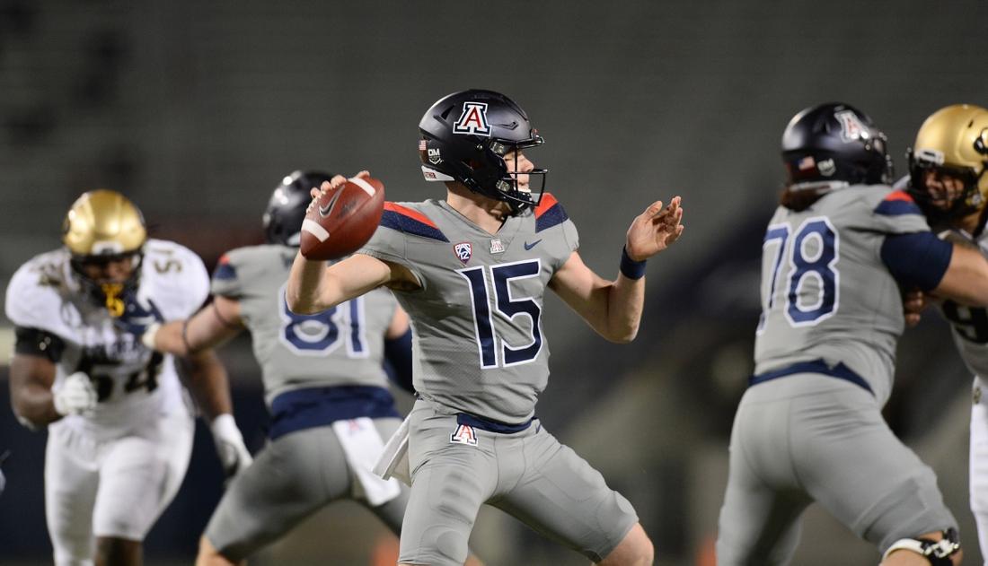 Dec 5, 2020; Tucson, Arizona, USA; Arizona Wildcats quarterback Will Plummer (15) throws a pass against the Colorado Buffaloes during the second half at Arizona Stadium. Mandatory Credit: Joe Camporeale-USA TODAY Sports