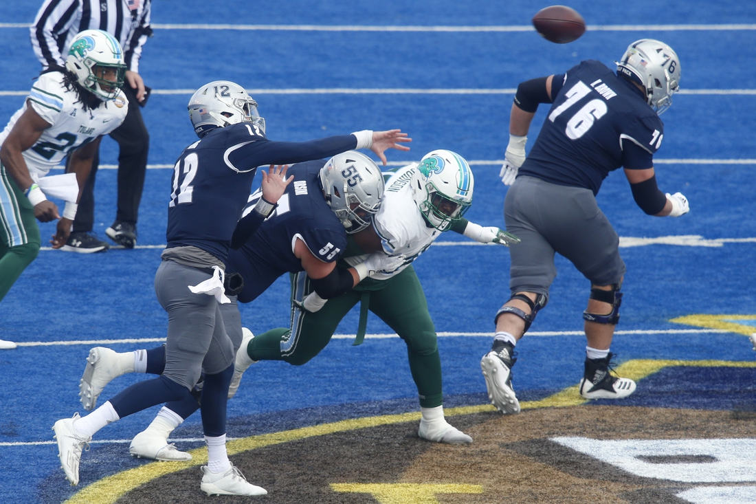 Dec 22, 2020; Boise, Idaho, USA; Nevada Wolf Pack quarterback Carson Strong (12) throws a pass  during the first half of the Famous Idaho Potato Bowl versus the Tulane Green Wave  at Albertsons Stadium. Mandatory Credit: Brian Losness-USA TODAY Sports
