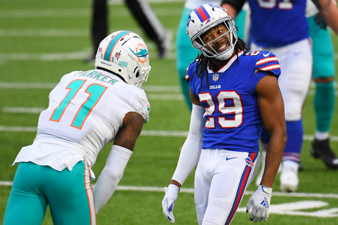 Jan 3, 2021; Orchard Park, New York, USA; Buffalo Bills cornerback Josh Norman (29) reacts in the direction of Miami Dolphins wide receiver DeVante Parker (11) following a defensive play during the third quarter at Bills Stadium. Mandatory Credit: Rich Barnes-USA TODAY Sports
