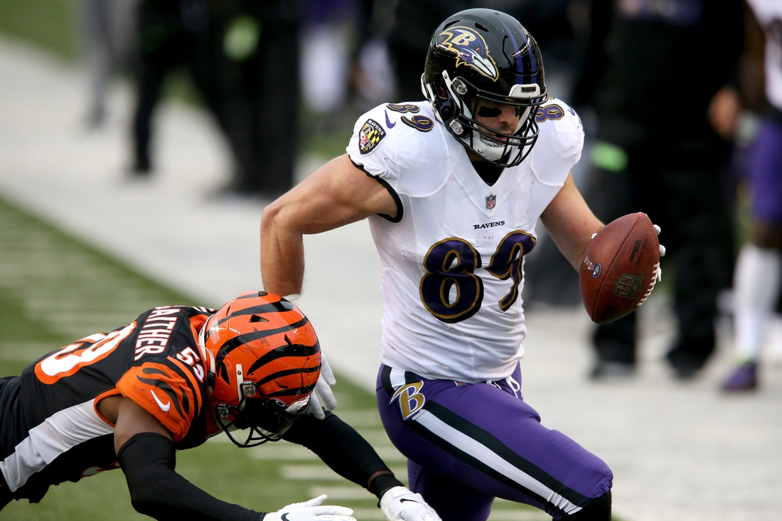 Baltimore Ravens tight end Mark Andrews (89) is pushed out of bounds by Cincinnati Bengals linebacker Akeem Davis-Gaither (59) in the third quarter during a Week 17 NFL football game, Sunday, Jan. 3, 2021, at Paul Brown Stadium in Cincinnati. The Baltimore Ravens won, 38-3. The Cincinnati Bengals finished with 2020 season 4-11-1.  Baltimore Ravens At Cincinnati Bengals Week 17 Jan 3