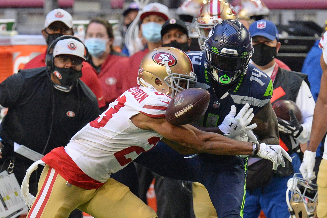 Jan 3, 2021; Glendale, Arizona, USA; San Francisco 49ers cornerback Ahkello Witherspoon (23) breaks up a pass intended for Seattle Seahawks wide receiver DK Metcalf (14) during the second half at State Farm Stadium. Mandatory Credit: Joe Camporeale-USA TODAY Sports