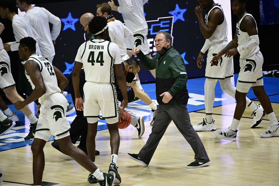 Mar 18, 2021; West Lafayette, Indiana, USA; Michigan State Spartans head coach Tom Izzo heads into the locker room as he talks with forward Gabe Brown (44) at half time during the First Four of the 2021 NCAA Tournament at Mackey Arena. Mandatory Credit: Marc Lebryk-USA TODAY Sports