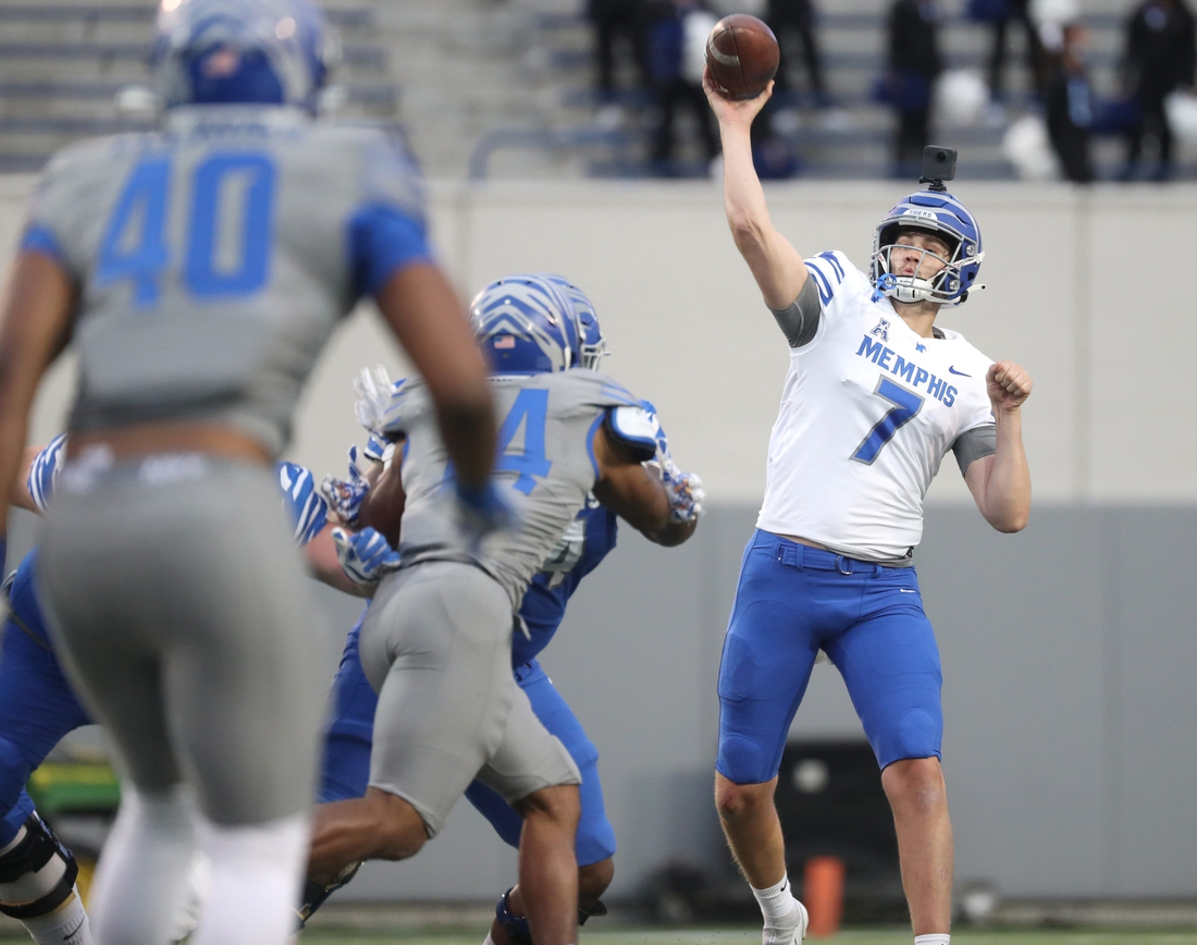 Memphis Tigers quarterback Grant Gunnell throws the ball during their Friday Night Stripes spring game at the Liberty Bowl Memorial Stadium on Friday, April 16, 2021.  A11i1727