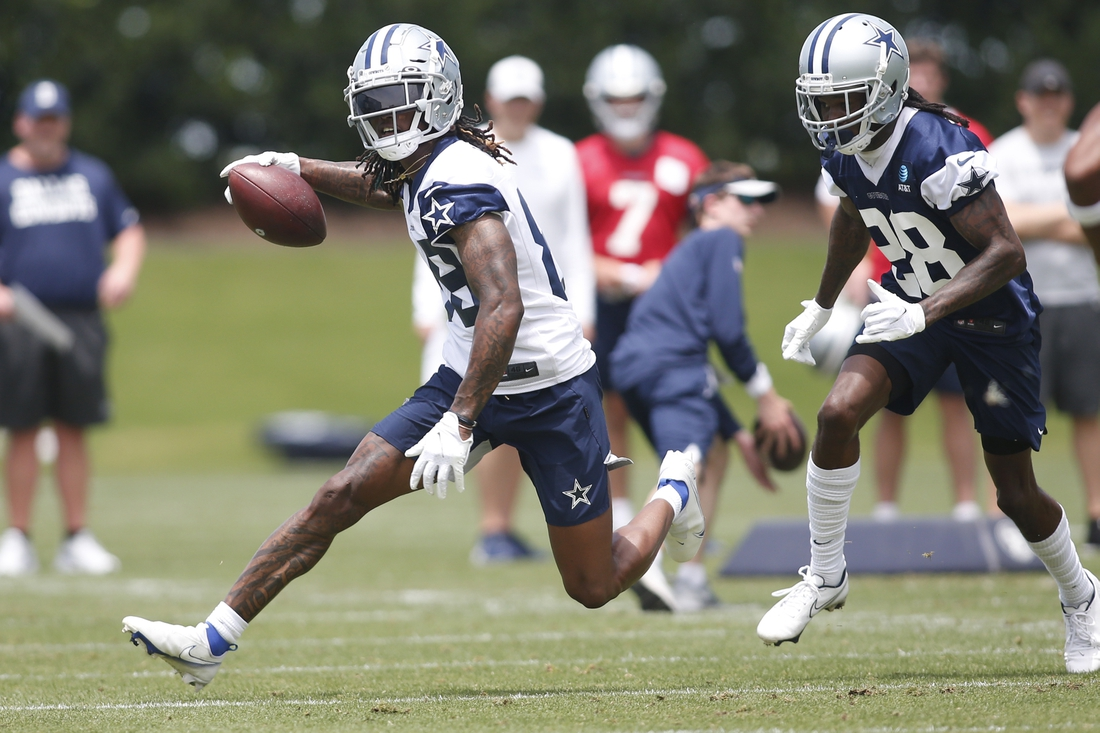 Jun 8, 2021; Frisco, TX, USA;  Dallas Cowboys wide receiver CeeDee Lamb (88) runs a drill against cornerback Maurice Canady (28) during voluntary Organized Team Activities at the Ford Center at the Star Training Facility in Frisco, Texas. Mandatory Credit: Tim Heitman-USA TODAY Sports