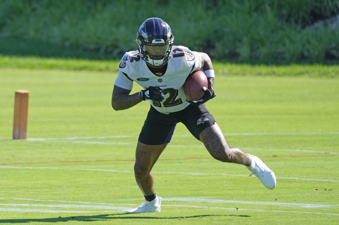 Jun 15, 2021; Owings Mills, Maryland, USA; Baltimore Ravens wide receiver Rashod Bateman (12) returns a punt during mandatory mini camp at the Under Armor Performance Center. Mandatory Credit: Mitch Stringer-USA TODAY Sports