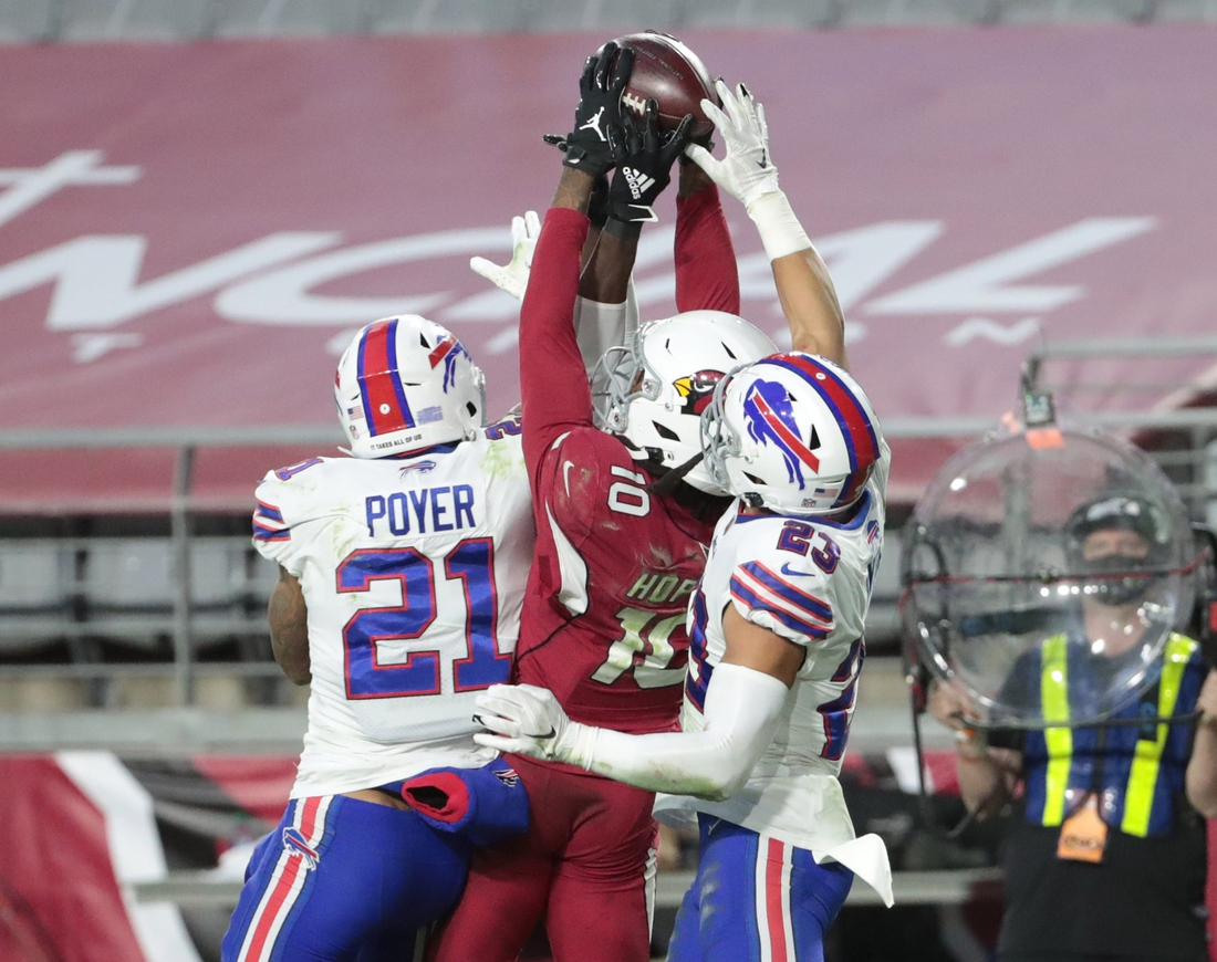 Arizona Cardinals wide receiver DeAndre Hopkins (10) catches the game-winning touchdown between Buffalo Bills safety Jordan Poyer (21), and safety Micah Hyde (23) during the fourth quarter at State Farm Stadium in Glendale, Ariz. Nov. 15, 2020. The Cardinals won 32-30.  Buffalo Bills Vs Arizona Cardinals
