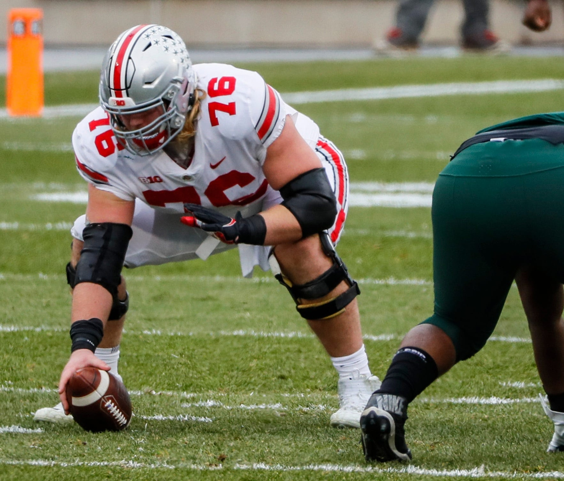 Ohio State Buckeyes offensive lineman Harry Miller (76) prepares to snap the ball during the first quarter of a NCAA Division I football game between the Michigan State Spartans and the Ohio State Buckeyes on Saturday, Dec. 5, 2020 at Spartan Stadium in East Lansing, Michigan.  Cfb Ohio State Buckeyes At Michigan State Spartans