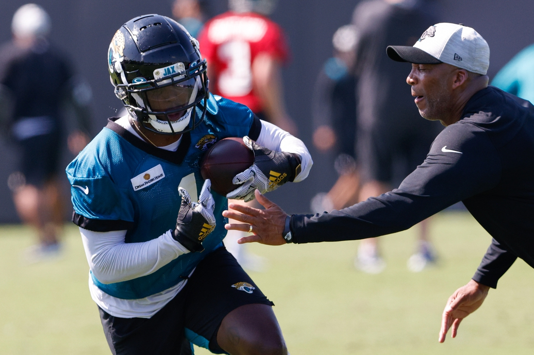 Jul 29, 2021; Jacksonville, FL, USA;  Jacksonville Jaguars running back Travis Etienne (1) participates in training camp at Dream Finders Homes practice field Mandatory Credit: Nathan Ray Seebeck-USA TODAY Sports