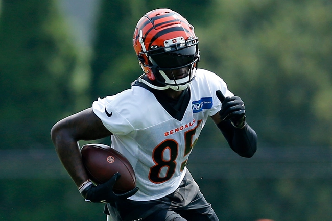 Cincinnati Bengals wide receiver Tee Higgins (85) runs with a catch during training camp practice at the Paul Brown Stadium practice facility in downtown Cincinnati on Thursday, July 29, 2021.  Cincinnati Bengals Training Camp