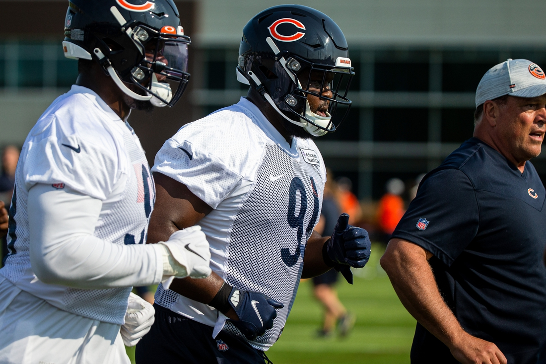 Jul 29, 2021; Lake Forest, IL, USA; Chicago Bears nose tackle Eddie Goldman (91) runs a lap around the field at the start of a Chicago Bears training camp session at Halas Hall. Mandatory Credit: Jon Durr-USA TODAY Sports