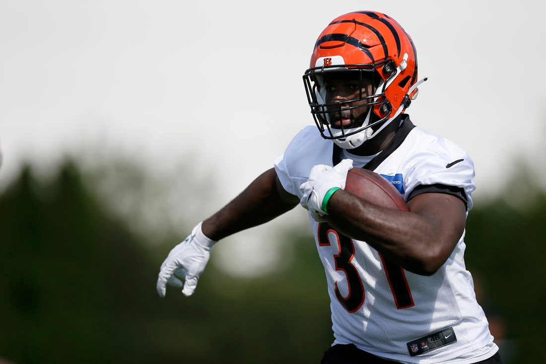 Cincinnati Bengals running back Jacques Patrick (31) runs the ball during training camp practice at the Paul Brown Stadium practice field in downtown Cincinnati on Monday, Aug. 2, 2021.  Cincinnati Bengals Camp