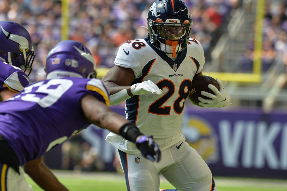 Aug 14, 2021; Minneapolis, Minnesota, USA; Denver Broncos running back Royce Freeman (28) runs the ball as Minnesota Vikings defensive back Kris Boyd (29) moves in for the tackle during the first quarter at U.S. Bank Stadium. Mandatory Credit: Jeffrey Becker-USA TODAY Sports