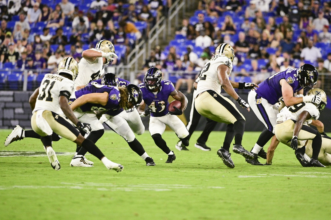 Aug 14, 2021; Baltimore, Maryland, USA;  Baltimore Ravens running back Justice Hill (43) rushes during the first half against the New Orleans Saints at M&T Bank Stadium. Mandatory Credit: Tommy Gilligan-USA TODAY Sports