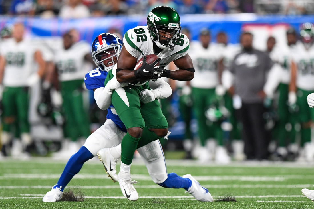 Aug 14, 2021; East Rutherford, New Jersey, USA; New York Jets wide receiver Jamison Crowder (82) runs the ball against New York Giants cornerback Darnay Holmes (30) during the first half at MetLife Stadium. Mandatory Credit: Dennis Schneidler-USA TODAY Sports