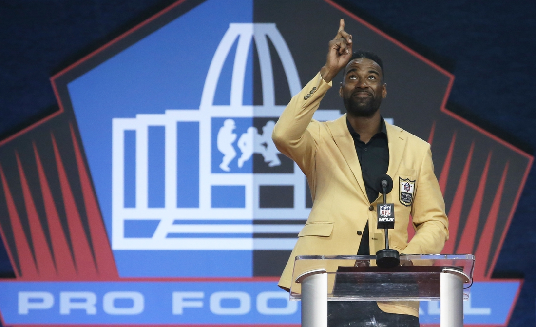 Aug 8, 2021; Canton, Ohio, USA;   Detroit Lions former receiver and inductee Calvin Johnson gestures as he delivers his acceptance speech  during the Class of 2021 NFL Hall of Fame induction ceremony at Tom Benson Hall of Fame Stadium. Mandatory Credit: Charles LeClaire-USA TODAY Sports