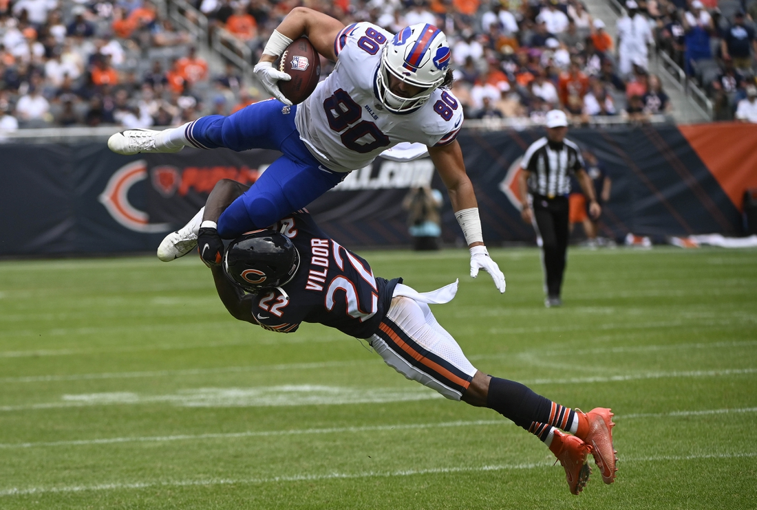 Aug 21, 2021; Chicago, Illinois, USA;  Buffalo Bills tight end Jacob Hollister (80) leaps over Chicago Bears cornerback Kindle Vildor (22) during the first half at Soldier Field. Mandatory Credit: Matt Marton-USA TODAY Sports