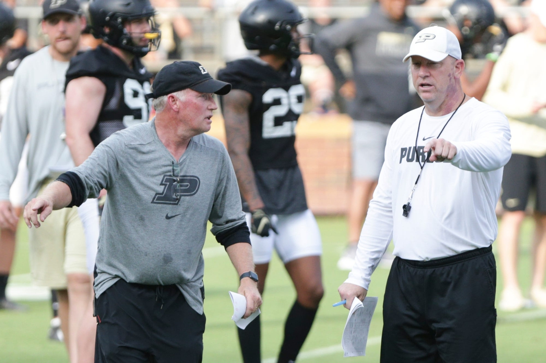 Purdue head coach Jeff Brohm talks with co-defensive coordinator and linebackers coach Brad Lambert during practice, Friday, Aug. 6, 2021 at Ross-Ade Stadium in West Lafayette.  Purdue Football Camp