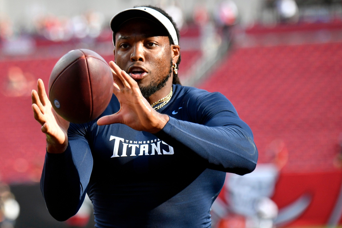 Tennessee Titans running back Derrick Henry (22) warms up before a preseason game against the Buccaneers at Raymond James Stadium Saturday, Aug. 21, 2021 in Tampa, Fla.  Titans Bucs 008