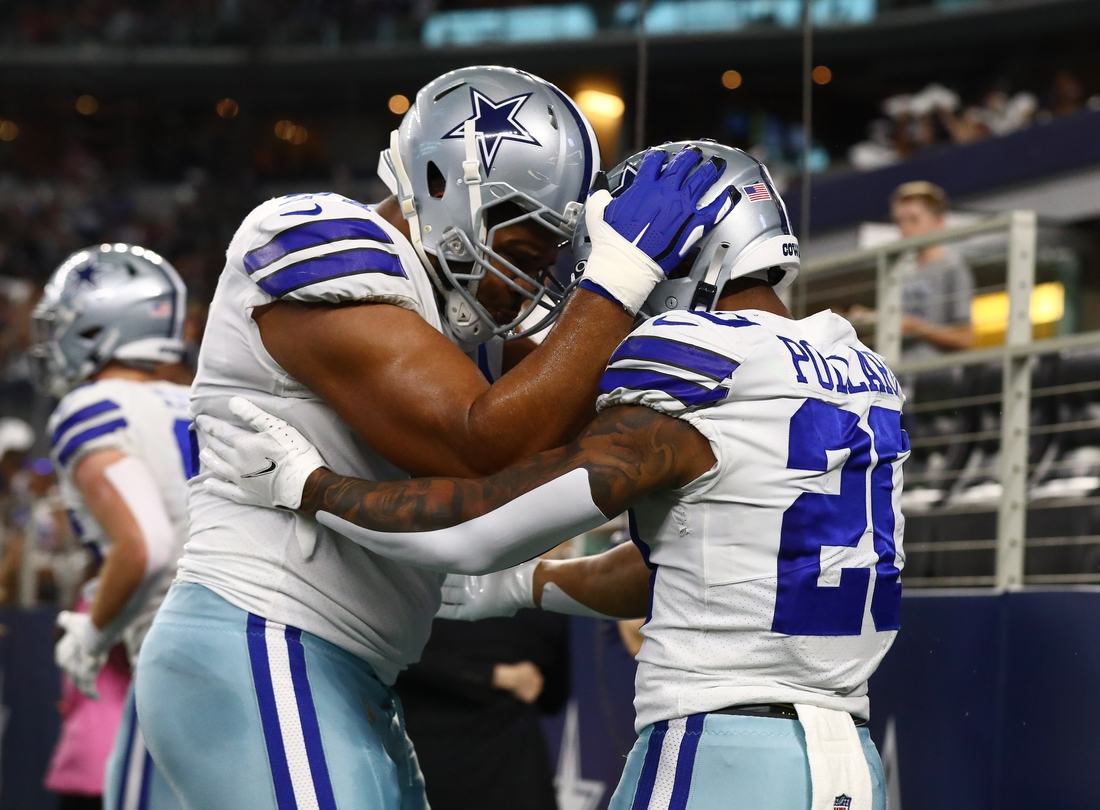 Aug 21, 2021; Arlington, Texas, USA; Dallas Cowboys running back Tony Pollard (20) celebrates a first quarter touchdown with tackle La'el Collins (71) against the Houston Texans at AT&T Stadium. Mandatory Credit: Matthew Emmons-USA TODAY Sports
